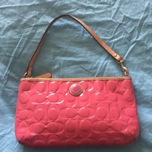 Large Coach pink wristlet wallet